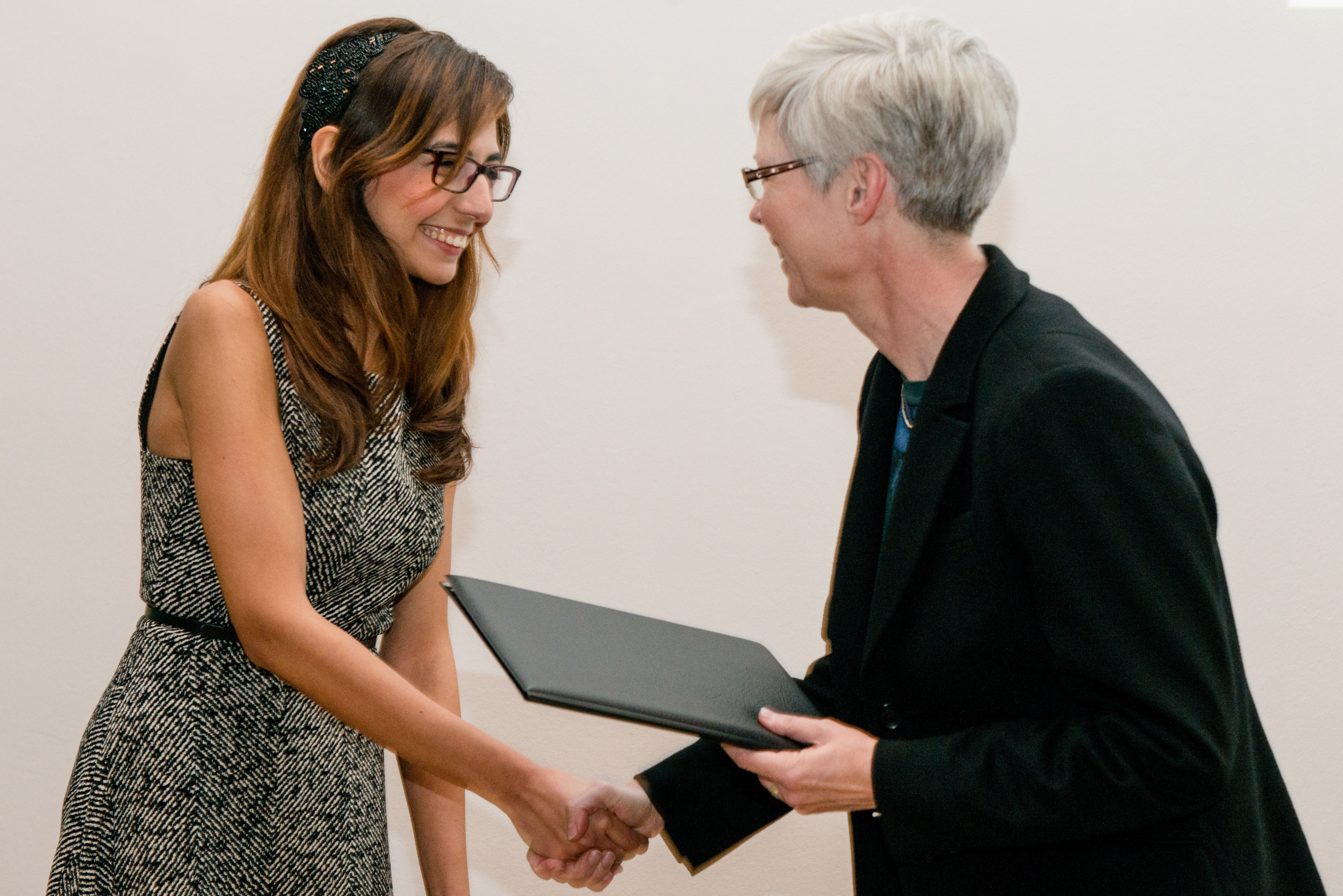 student receives certificate from prorector